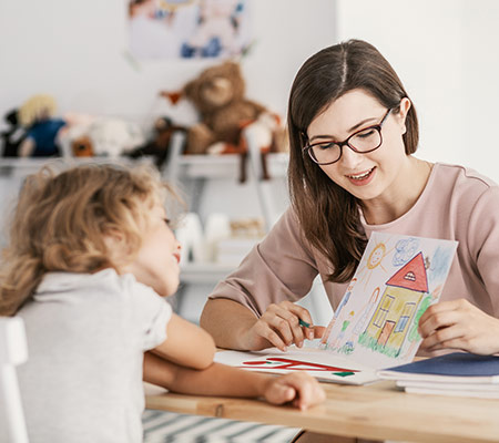 woman and child looking at drawn picture